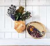 Medicinal herbs and flowers. Healing herbs. Medical herbs concept on a light wooden background royalty free stock image
