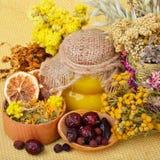 Medicinal herbs with honey Royalty Free Stock Photo