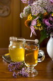 Medicinal herbs, honey, herbal tea Royalty Free Stock Photo