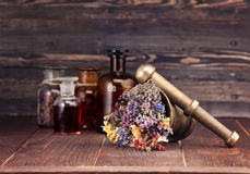 Medicinal Herbs Mortar And Bottles Tincture. Royalty Free Stock Photography