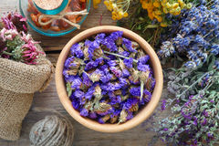 Medicinal herbs, mortar and bag of dry healthy flowers. Royalty Free Stock Photo