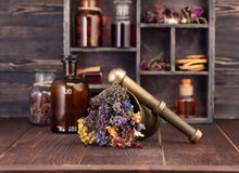 Medicinal herbs mortar and bottles tincture. Herbal medicine concept Royalty Free Stock Photo