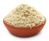 Medicinal Isabgol or psyllium husks on a clay pot. Over white background stock image