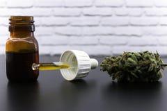 Medicinal marijuana buds and cannabis oil stock photos
