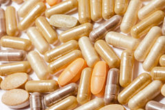 Medicinal pills piled up a bunch. Of closeup Stock Photo
