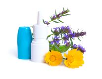 Medicinal plants Calendula and Hyssop with Nose spray. Isolated on white.  royalty free stock images