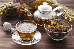 Medicinal Tea In Glass Cup With Dried Herb In Bowl Royalty Free Stock Images