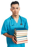 Medicinare med böcker Fotografering för Bildbyråer