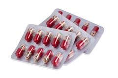 medicinas e cápsulas nos pacotes isolados no fundo branco imagem de stock