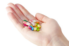 Medicinas e comprimidos na palma Imagem de Stock Royalty Free