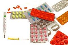 Medicinas em um fundo branco Fotografia de Stock Royalty Free