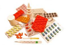 Medicinas em um fundo branco Fotografia de Stock