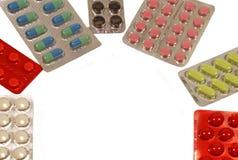 Medicinas en un fondo blanco Foto de archivo libre de regalías
