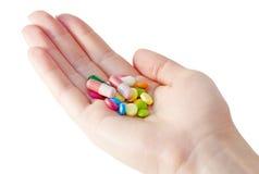 Medicinas y píldoras en la palma Imagen de archivo libre de regalías