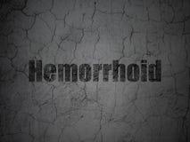 Medicinbegrepp: Hemorrhoid på grungeväggbakgrund arkivbilder