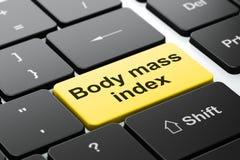 Medicinbegrepp: Index för kroppmass på bakgrund för datortangentbord Arkivbilder