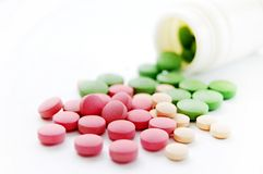 Medicine. A lot of colorful pills with bottle Stock Image