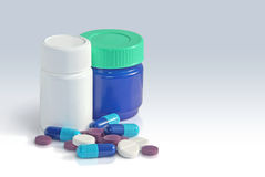 Medicine. Tablets and capsules near two bottles Stock Photo