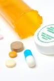 Medicine. Prescription pills in a yellow bottle Stock Photos