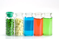 Medicine. Glass bottle with pills and solution Royalty Free Stock Photography