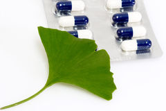 Medicine. Ginkgo biloba leaf with pills on bright background Stock Photography