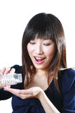 Medicine. Asian girl pour pills on the hand Royalty Free Stock Images