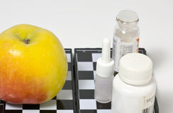 Medicine and an apple Stock Photography