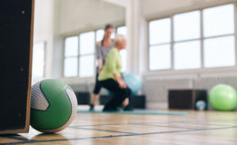 Medicine ball lying on gym floor Stock Photography