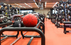 Medicine ball and sports equipment in gym Royalty Free Stock Photos