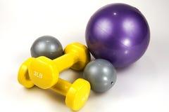 Medicine Balls and Lifting Weights. Close up shot of three medicine balls and two lifting weights Royalty Free Stock Photo