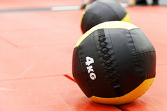 Medicine balls on red mats in the athletic gym Stock Image