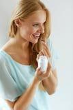 Medicine. Beautiful Girl Taking Medication, Vitamins, Pills. Royalty Free Stock Photography