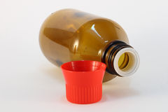 Medicine bottle. One bottle for medical fluids with red cap Royalty Free Stock Photography
