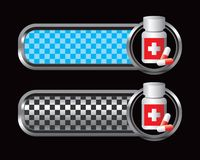 Medicine bottle on blue and black checkered tabs Royalty Free Stock Photography