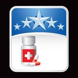 Medicine bottle on blue star backdrop Stock Images