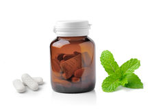 Medicine bottle of brown glass pill and mint Royalty Free Stock Photography