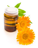 Medicine bottle and calendula flower Stock Photo