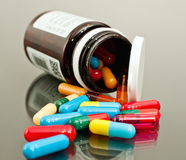 Medicine bottle and capsules Stock Photography
