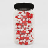 Medicine bottle with capsules isolated on white background. Royalty Free Stock Photos