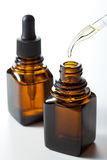 Medicine bottle and dropper Royalty Free Stock Photo
