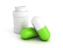 Medicine bottle and green pills on white Stock Photo