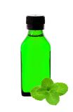 Medicine bottle with green syrup and mint herb Stock Photos