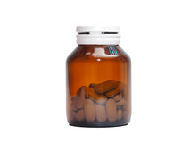 Medicine bottle isolation on white. Tea colored medicine bottle isolated on white background Royalty Free Stock Photo