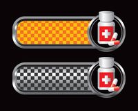 Medicine bottle on orange and black tabs Royalty Free Stock Images