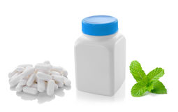 Medicine bottle pill and mint  on white background Royalty Free Stock Image