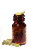 Medicine bottle and pills. A brown medicine bottle and pills Stock Photography