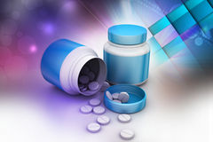 Medicine bottle and pills Stock Photo