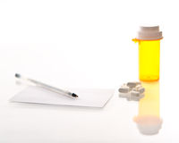 Medicine bottle, pills, prescription and pen Stock Images