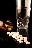 Medicine bottle with spilled pills Royalty Free Stock Photo