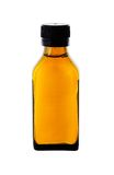 Medicine bottle with yellow syrup Stock Photos
